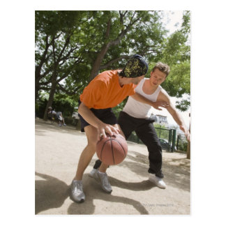 Men playing basketball outdoors post cards