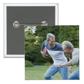 Men playing football 15 cm square badge