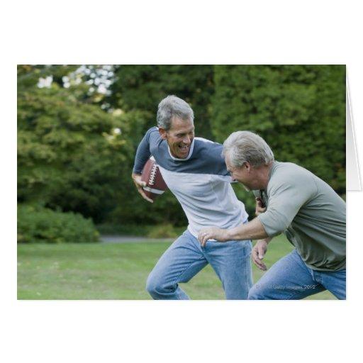 Men playing football card
