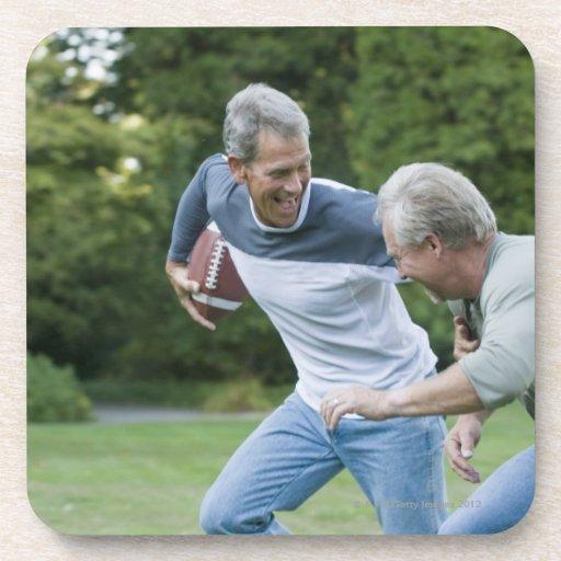 Men playing football beverage coaster