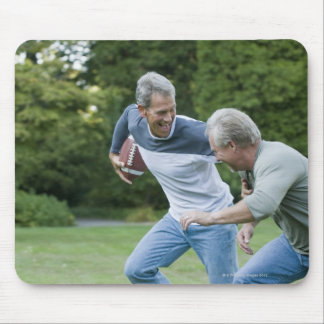 Men playing football mouse pad