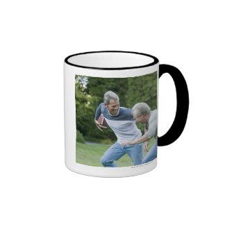 Men playing football mug