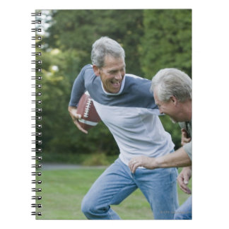 Men playing football spiral note books