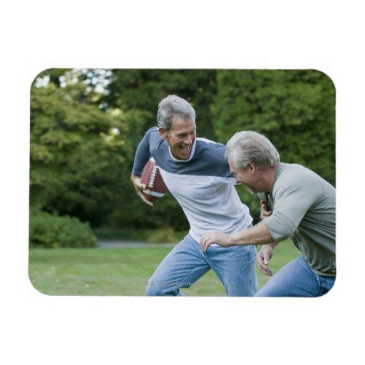 Men playing football vinyl magnets