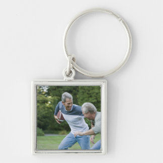 Men playing football Silver-Colored square key ring