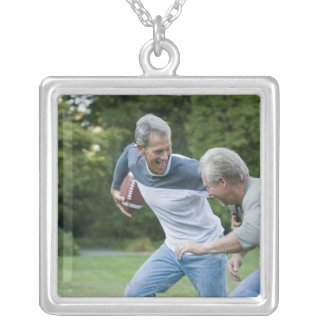 Men playing football silver plated necklace