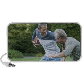Men playing football portable speaker