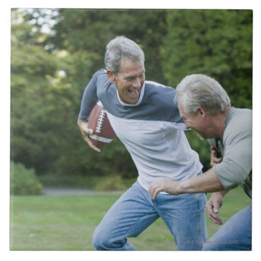 Men playing football tiles