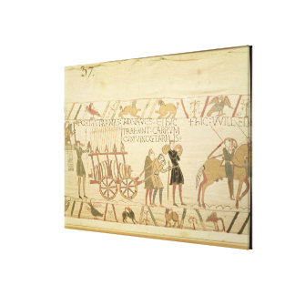 Men pulling a cart loaded with wine and arms canvas print