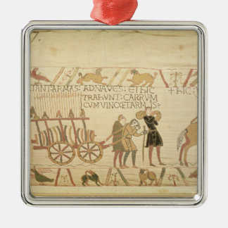 Men pulling a cart loaded with wine and arms christmas ornament