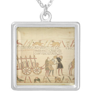 Men pulling a cart loaded with wine and arms silver plated necklace