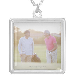 Men pulling golf carts silver plated necklace