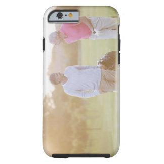 Men pulling golf carts tough iPhone 6 case