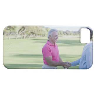 Men shaking hands on golf course iPhone 5 cover