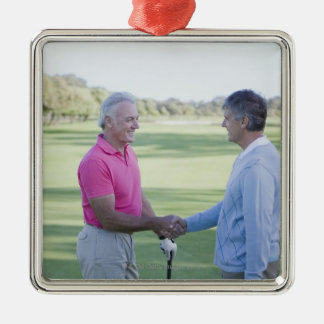 Men shaking hands on golf course Silver-Colored square decoration