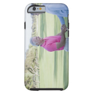 Men shaking hands on golf course tough iPhone 6 case