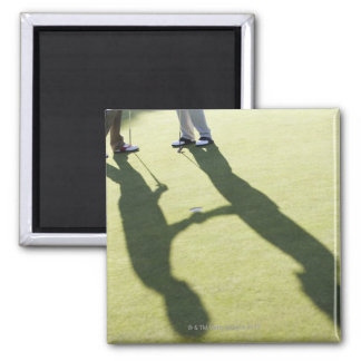 Men shaking hands on putting green square magnet