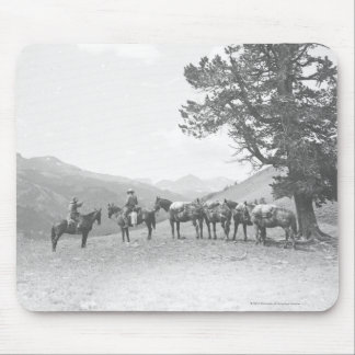 Men with packhorses looking over a hill mouse mat