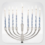 Menorah with burning candles square sticker
