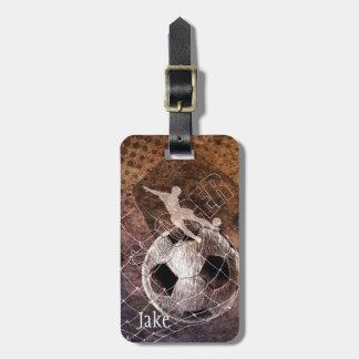 mens soccer grunge player kicking bag tag