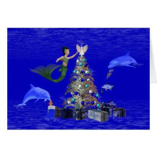 Mermaid decorating the christmas tree greeting card