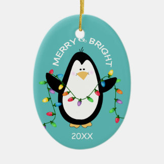 Merry and Bright Christmas Penguin Fun Blue Oval Christmas Ornament