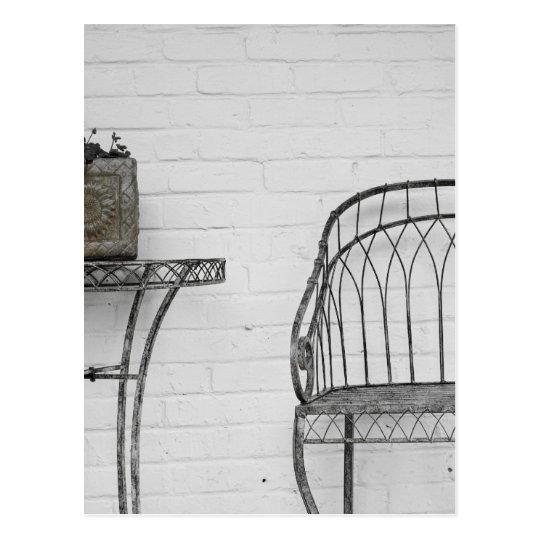 Metal chair and table postcard