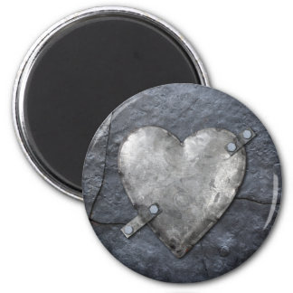 metal heart bolted to metal fridge magnet