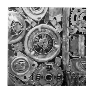 Metal machine parts welded together tile