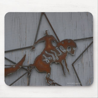 Metal sculpture of cowboy on bucking bronco mouse pad