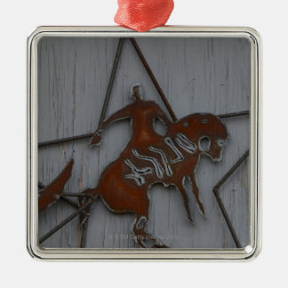 Metal sculpture of cowboy on bucking bronco Silver-Colored square decoration