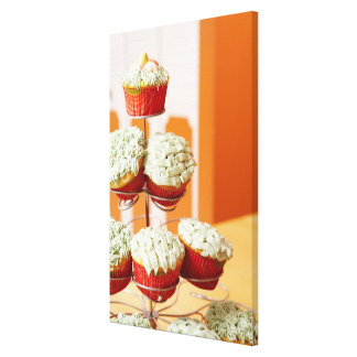 Metal tree displaying frosted cupcakes canvas print