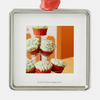 Metal tree displaying frosted cupcakes christmas ornament