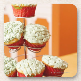 Metal tree displaying frosted cupcakes coaster