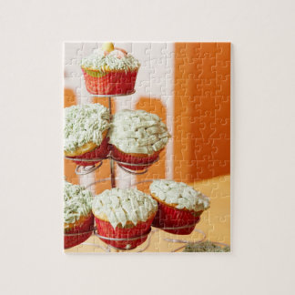 Metal tree displaying frosted cupcakes jigsaw puzzle