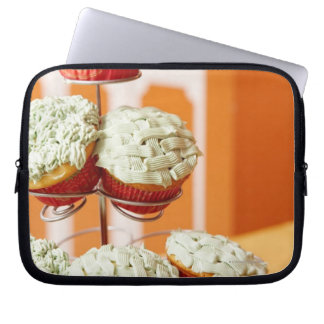 Metal tree displaying frosted cupcakes laptop sleeve