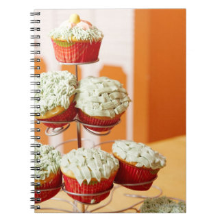 Metal tree displaying frosted cupcakes spiral notebook