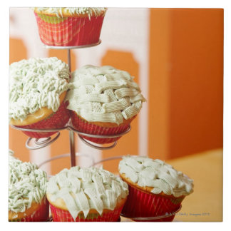 Metal tree displaying frosted cupcakes tile