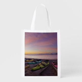 Mexico, Baja, Sea of Cortez. Sea kayaks and Reusable Grocery Bag