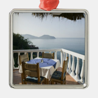 Mexico, Guerrero, Zihuatanejo. Cafe Table over Christmas Ornament