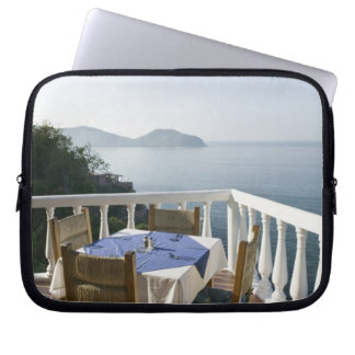 Mexico, Guerrero, Zihuatanejo. Cafe Table over Laptop Sleeve