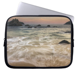 Mexico, Guerrero, Zihuatanejo.  Surf along a Laptop Sleeve