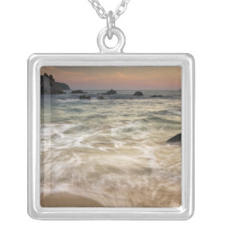 Mexico, Guerrero, Zihuatanejo.  Surf along a Silver Plated Necklace