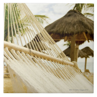 Mexico, Playa Del Carmen, hammock on beach Tile