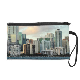 Miami skyscrapers against wide clear sky wristlet purses