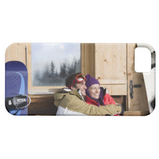 Mid adult couple embracing outside log cabin barely there iPhone 5 case