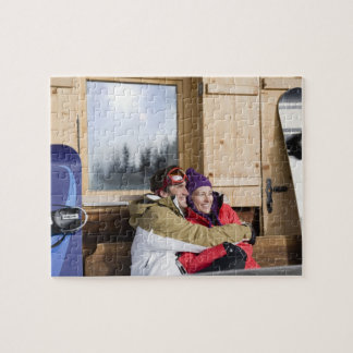 Mid adult couple embracing outside log cabin jigsaw puzzle