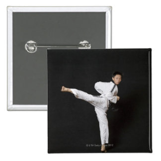 Mid adult man performing the side kick 15 cm square badge