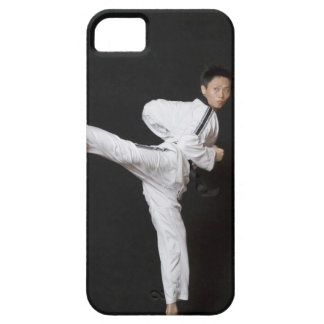 Mid adult man performing the side kick case for the iPhone 5