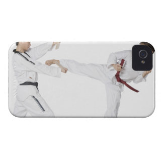 Mid adult man practicing kickboxing with a young iPhone 4 cover